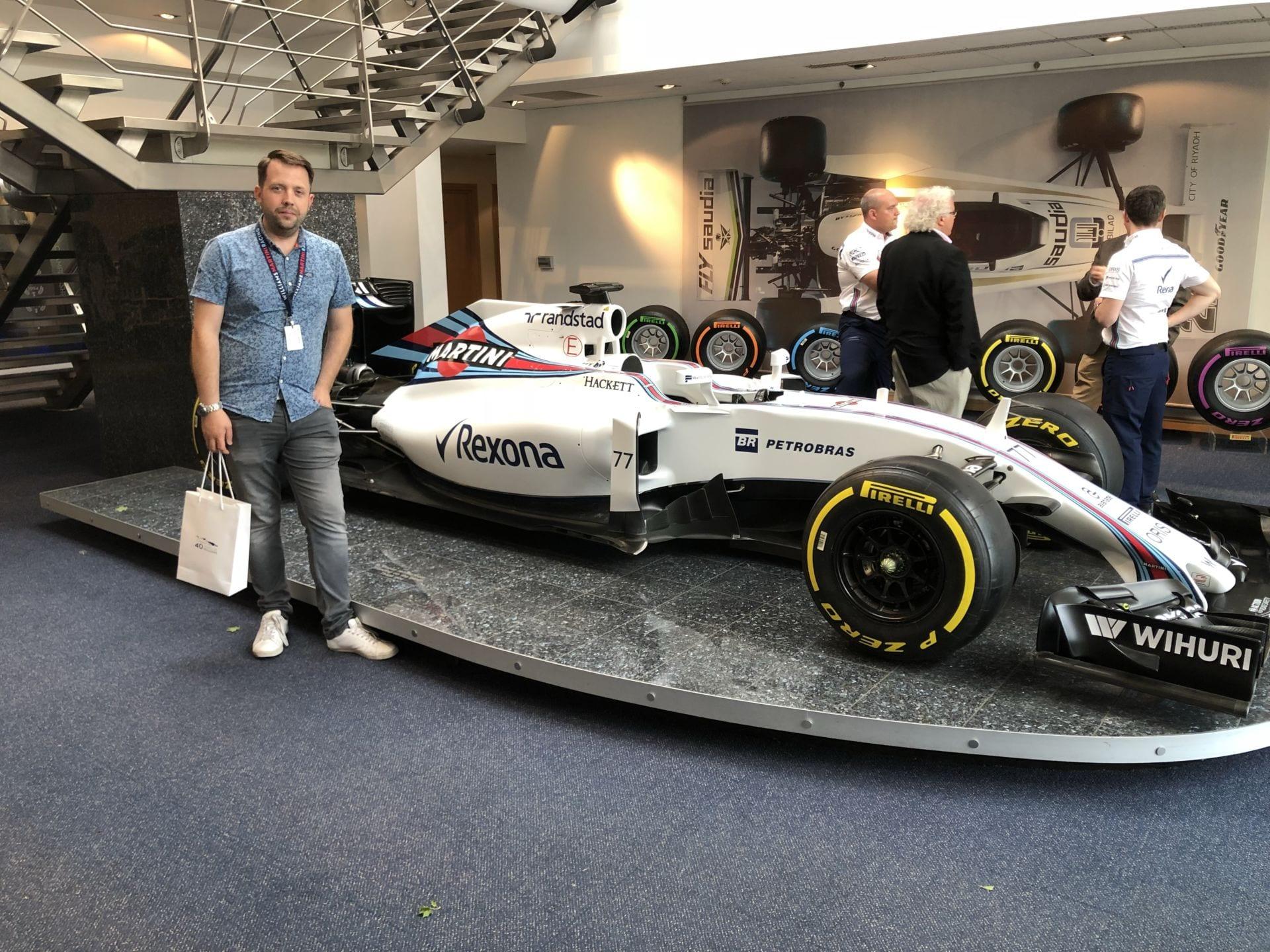 Man by F1 car